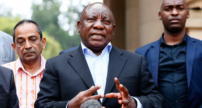 In this file photo taken on March 22, 2020 South African President Cyril Ramaphosa (C) conducts a media briefing at the end of a meeting with various business leaders and political party leaders on matters relating to the COVID-19 outbreak at the Union Buildings in Pretoria. Phill Magakoe / AFP
